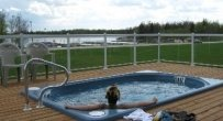 hot tub overlooking Winnipeg River is things to do at Wilderness Edge